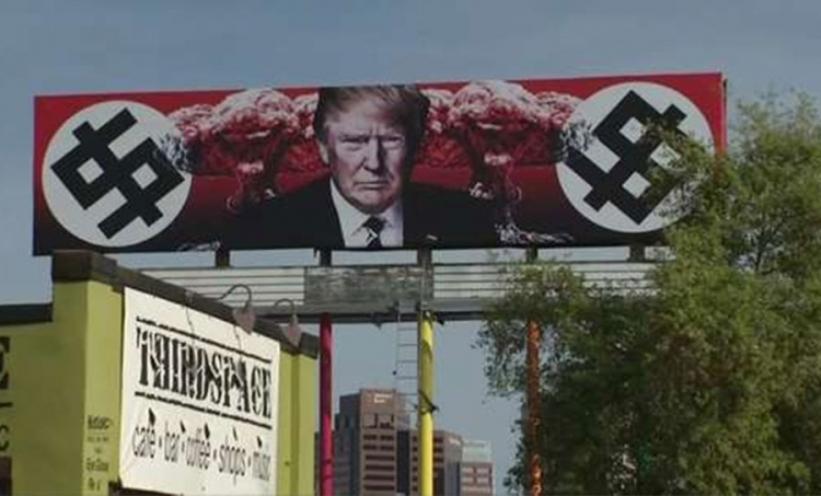 Tramp okružen nacističkim svastikama na bilbordu